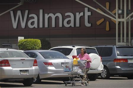 A shopper carts her purchases from a Wal-Mart store in Mexico City, April 24, 2012. REUTERS/Edgard Garrido