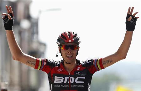 BMC Racing Team rider Alessandro Ballan of Italy celebrates winning the last stage of the Eneco Tour cycling race in Geraardsbergen August 12, 2012. REUTERS/Francois Lenoir
