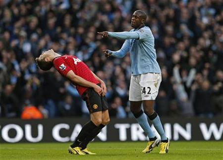 Manchester City's Yaya Toure (R) celebrates his goal against Manchester United during their English Premier League soccer match at The Etihad Stadium in Manchester, northern England December 9, 2012. REUTERS/Eddie Keogh