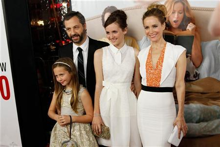 Writer/director/producer Judd Apatow arrives with his family and cast members (L-R) Iris Apatow, Maude Apatow and Leslie Mann at the premiere of the movie ''This is 40'' at Grauman's Chinese Theatre in Hollywood, California December 12, 2012. REUTERS/Patrick T. Fallon