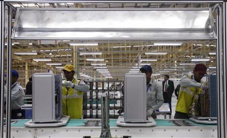 Employees work at an air conditioner production line in a factory at Jhajjar district in Haryana December 12, 2012. REUTERS/Mansi Thapliyal