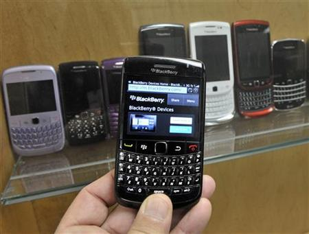 A BlackBerry device is shown in front of products displayed in a glass cabinet at the Research in Motion offices in Waterloo November 14, 2012. RIM is set to launch its new platform BlackBerry 10, as well as the unveiling of the first two BlackBerry 10 smartphones, simultaneously in multiple countries around the world on January 30, 2013. REUTERS/Mike Cassese (CANADA - Tags: BUSINESS TELECOMS)