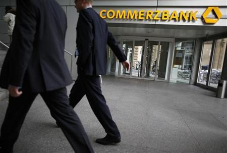 Men walk in front of Germany's Commerzbank headquarters in Frankfurt, November 8, 2012. Commerzbank, Germany's No.2 bank, missed third-quarter profit forecasts and said it was unlikely to pay a dividend for this year or next as a weakening European economy hampers its fight to recover from the 2008 financial crisis. REUTERS/Lisi Niesner (GERMANY - Tags: BUSINESS)