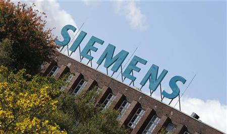 The logo of Siemens AG company is pictured atop a factory in Berlin October 9, 2012. REUTERS/Fabrizio Bensch (GERMANY - Tags: BUSINESS LOGO)