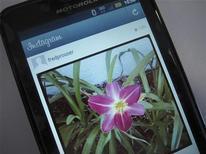Le service de partage de photographies en ligne Instagram a partiellement renoncé aux modifications prévues de ses conditions d'utilisation, qui ont créé ces derniers jours une vive controverse sur l'utilisation des images et des données personnelles de ses membres. /Photo d'archives/REUTERS/Fred Prouser