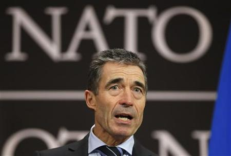 NATO Secretary-General Anders Fogh Rasmussen holds a news conference during a NATO foreign ministers meeting at the Alliance's headquarters in Brussels December 4, 2012. REUTERS/Francois Lenoir