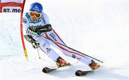 Marlies Schild of Austria clears a gate during the second run of the Giant slalom race at the women's Alpine skiing World Cup at the Corviglia in the Swiss mountain resort of St. Moritz December 9, 2012. REUTERS/Arnd Wiegmann