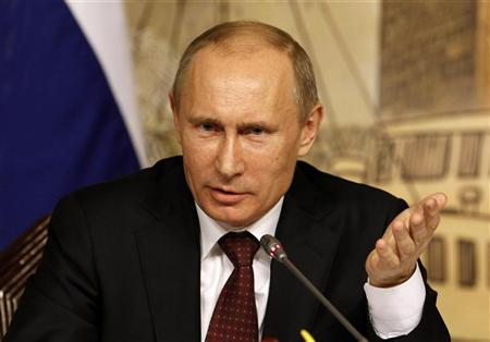 Russia's President Vladimir Putin gestures during a news conference after their meeting with Turkey's Prime Minister Tayyip Erdogan in Istanbul December 3, 2012. REUTERS/Osman Orsal