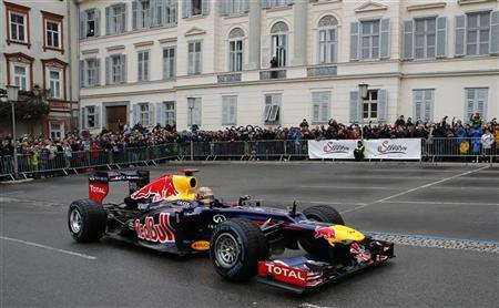Red Bull three-time Formula One world champion Sebastian Vettel of Germany drives his racing car during a promotional event in the Austrian city of Graz December 1, 2012. REUTERS/Leonhard Foeger
