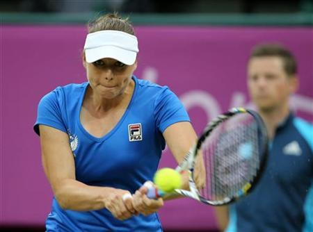 Russia's Vera Zvonareva returns to Serena Williams of the U.S. in their women's singles tennis match at the All England Lawn Tennis Club during the London 2012 Olympic Games August 1, 2012. REUTERS/Sergio Moraes/Files