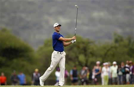 Martin Kaymer of Germany watches his shot on the third fairway during the 2012 Nedbank Golf Challenge in Sun City, December 2, 2012. REUTERS/Siphiwe Sibeko