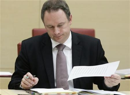 Bavarian Finance Minister Georg Fahrenschon looks at some papers at the Bavarian state parliament in Munich December 15, 2009. REUTERS/Michael Dalder