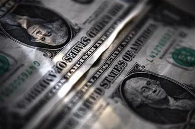 Dollar rises in thin trade, ends 2012 lower overall