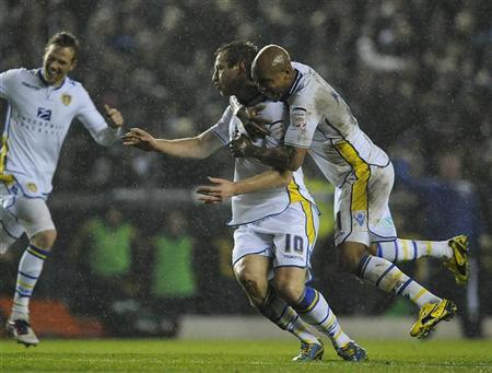 Leeds United's Luciano Becchio (C) celebrates his goal with El-Hadji Diouf (R) during their English League Cup quarter-final soccer match against Chelsea in Leeds, northern England December 19, 2012. REUTERS/Nigel Roddis