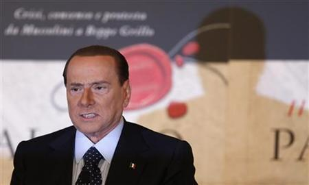 Former Italian Prime Minister Silvio Berlusconi reacts during a book launch of his friend, TV presenter Bruno Vespa, in Rome December 12, 2012. REUTERS/Alessandro Bianchi