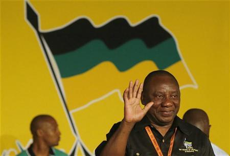 Cyril Ramaphosa (R) celebrates his election as party Deputy President at the National Conference of the ruling African National Congress (ANC) in Bloemfontein December 18, 2012. REUTERS/Mike Hutchings