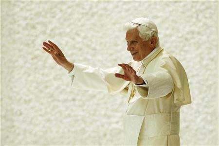 Pope Benedict XVI waves as he leaves after leading his Wednesday general audience in Paul VI's Hall at the Vatican December 19, 2012. REUTERS/Giampiero Sposito