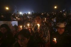Women participate in a candlelight vigil to show solidarity with a rape victim at India Gate in New Delhi December 21, 2012. REUTERS/Adnan Abidi
