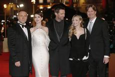 "Actors Russell Crowe, Anne Hathaway, Hugh Jackman, Amanda Seyfried and director Tom Hooper (L-R) pose for photographers as they arrive for the world premiere of ""Les Miserables"" in London December 5, 2012. REUTERS/Suzanne Plunkett"