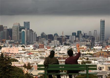 Two men look out over the San Francisco skyline from above Dolores Park, following a rain shower in San Francisco, California May 3, 2012. REUTERS/Robert Galbraith