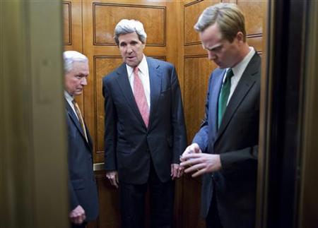 Senator John Kerry (C) speaks with Senator Jeff Sessions (L) after a vote on Capitol Hill in Washington December 17, 2012. REUTERS/Joshua Roberts