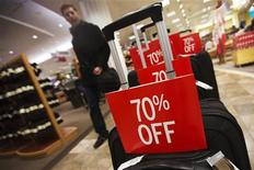 A man walks by merchandise with for sale signs at a shopping mall during the Christmas shopping season in Toronto, December 7, 2012. REUTERS/Mark Blinch
