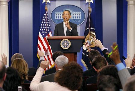 U.S. President Barack Obama takes questions from members of the media in the White House Briefing Room December 19, 2012. REUTERS/Kevin Lamarque