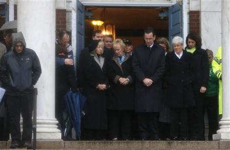 Connecticut Governor Daniel Malloy (C) stands with others on the steps of Edmond Town Hall during a moment of silence and ringing of church bells at 9:30 a.m. EDT for victims of the December 14 shootings at the Sandy Hook Elementary school in Newtown, Connecticut, December 21, 2012. REUTERS/Mike Segar