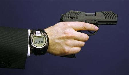 A man holds a prototype of a smart gun by Armatix during the International Guns Exhibition 'IWA & OutdoorClassics' in Nuremberg March 13, 2009. REUTERS/Michaela Rehle
