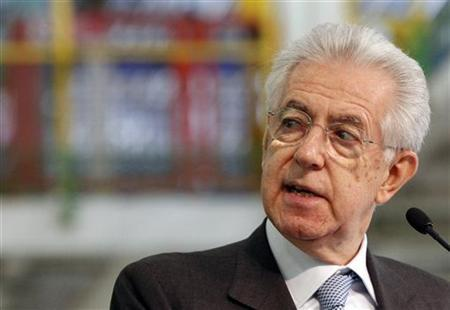 Italy's Prime Minister Mario Monti (C) looks as he makes his speech during a visit to the Fiat car factory in the southern city of Melfi December 20, 2012. REUTERS/Ciro De Luca