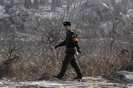A North Korean soldier walks on the banks of Yalu River in the North Korean town of Sinuiju, opposite the Chinese border city of Dandong, December 15, 2012. REUTERS/Jacky Chen