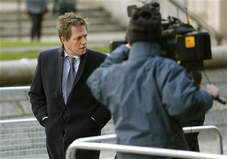 Actor Hugh Grant, a high profile campaigner on press intrusion, arrives to attend the release of Lord Justice Brian Leveson report on media practices in central London November 29, 2012. REUTERS/Andrew Winning