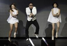 "South Korean rapper Psy performs at KIIS FM's Jingle Ball concert in Los Angeles, California in this December 3, 2012 file photo. Psy's infectious viral hit song, ""Gangnam Style,"" made history on December 21, 2012 as the first ever video on YouTube to reach 1 billion views, adding yet another record to the song's juggernaut journey into mainstream pop.Picture taken December 3, 2012. REUTERS/Mario Anzuoni/Files"