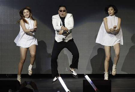 South Korean rapper Psy performs at KIIS FM's Jingle Ball concert in Los Angeles, California in this December 3, 2012 file photo. Psy's infectious viral hit song, ''Gangnam Style,'' made history on December 21, 2012 as the first ever video on YouTube to reach 1 billion views, adding yet another record to the song's juggernaut journey into mainstream pop.Picture taken December 3, 2012. REUTERS/Mario Anzuoni/Files