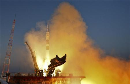 The Soyuz TMA-07M spacecraft carrying the International Space Station (ISS) crew of U.S. astronaut Thomas Marshburn, Russian cosmonaut Roman Romanenko and Canadian astronaut Chris Hadfield blasts off from its launch pad at the Baikonur cosmodrome December 19, 2012. REUTERS/Shamil Zhumatov