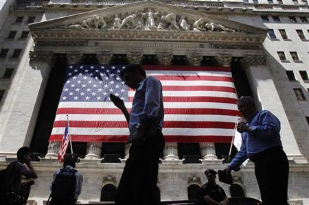 People walk outside the New York Stock Exchange in New York August 8, 2011. REUTERS/Shannon Stapleton