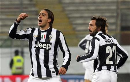Juventus' Alessandro Matri (L) celebrates next to team mate Andrea Pirlo after scoring against Cagliari during their Italian Serie A soccer match at Tardini stadium in Parma, December 21, 2012. REUTERS/Stefano Rellandini