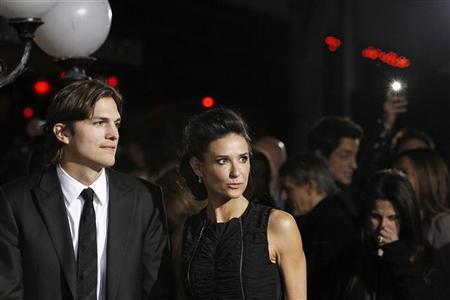 Cast member Ashton Kutcher and his wife actress Demi Moore attend the premiere of ''No Strings Attached'' at the Regency Village theatre in Los Angeles January 11, 2011. REUTERS/Mario Anzuoni