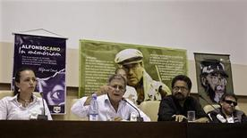 "Members of the Revolutionary Armed Forces of Colombia (FARC) rebel group (L-R) Tanja Nijmeijer of the Netherlands, Ricardo Tellez, FARC lead negotiator Ivan Marquez and Jesus Santrich attend a news conference in Havana December 21, 2012. Talks to end Colombia's bloody, half-century-long conflict with Marxist-led FARC rebels have made progress, but many challenges lie ahead, the government's top negotiator said on Friday. Former vice president Humberto de la Calle, speaking after the two sides finished their second round of meetings and broke until Jan. 14, said they had agreed on some ""unprecedented mechanisms"" for civic input into the peace process. REUTERS/Enrique De La Osa"