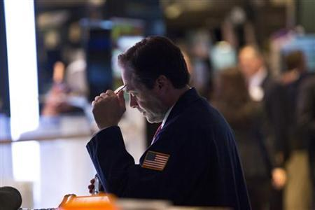 A trader works on the floor of the New York Stock Exchange in New York, December 21, 2012. REUTERS/Andrew Burton