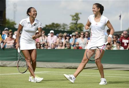 Heather Watson of Britain (L) and her partner Laura Robson of Britain laugh during their women's doubles tennis match against Hsieh Su-Wei of Taiwan and Sabine Lisicki of Germany at the Wimbledon tennis championships in London June 28, 2012. REUTERS/Dylan Martinez