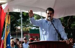 Venezuelan vice president Nicolas Maduro reads a statement about President Hugo Chavez's health condition in Guarico, in this Miraflores Palace handout photo, taken December 20, 2012. REUTERS/Handout/Miraflores Palace