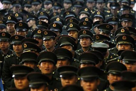 Soldiers of the Chinese People's Liberation Army (PLA) attend a farewell ceremony for veterans near Hangzhou, Zhejiang province, November 30, 2012. REUTERS/Stringer/Files