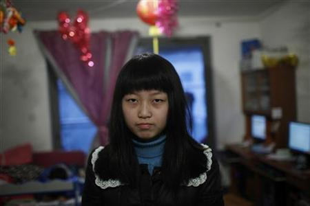 Zhan Haite poses for a picture at home in Shanghai, December 21, 2012. REUTERS/Aly Song