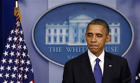 U.S. President Barack Obama looks down while speaking about the fiscal cliff at the White House in Washington December 21, 2012. Obama on Friday urged lawmakers to reach agreement on averting tax hikes on the middle class, saying he was ready and willing to do what it takes to get a deal by Jan. 1. REUTERS/Kevin Lamarque (UNITED STATES - Tags: POLITICS BUSINESS)