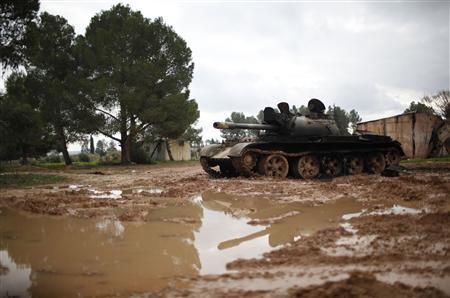 A damaged tank is seen at the Free Syrian Army controlled infantry college in the country side in Aleppo December 21, 2012. REUTERS/Ahmed Jadallah