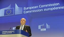 European Union Competition Commissioner Joaquin Almunia gestures during a news conference at the EU Commission headquarters in Brussels December 5, 2012. Philips, LG Electronics , Samsung SDI and three other firms were fined a record 1.47 billion euros ($1.92 billion) by EU antitrust regulators for fixing prices of TV and monitor cathode-ray tubes for nearly a decade. The European Commission slapped the biggest penalty, of 313.4 million euros, on Dutch-based Philips on Wednesday. REUTERS/Laurent Dubrule (BELGIUM - Tags: POLITICS BUSINESS SCIENCE TECHNOLOGY)