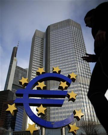 A man walks next to the Euro currency sign in front of the European Central Bank (ECB) headquarters in Frankfurt December 6, 2012. The European Central Bank held interest rates at a record low of 0.75 percent on Thursday, leaving investors to shift their attention to new economic forecasts for clues about possible cuts next year. REUTERS/Lisi Niesner (GERMANY - Tags: BUSINESS)