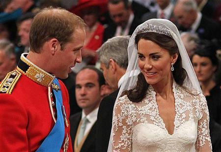Prince William, and Kate Middleton stand before the Archbishop of Canterbury, Rowan Williams, during their wedding ceremony In Westminster Abbey, in central London April 29, 2011. REUTERS/Dominic Lipinski/Pool