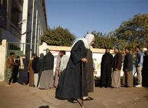 A man leaves a voting centre after casting his ballot in the final stage of a referendum on Egypt's new constitution in Giza, south of Cairo, December 22, 2012. REUTERS/Khaled Abdullah